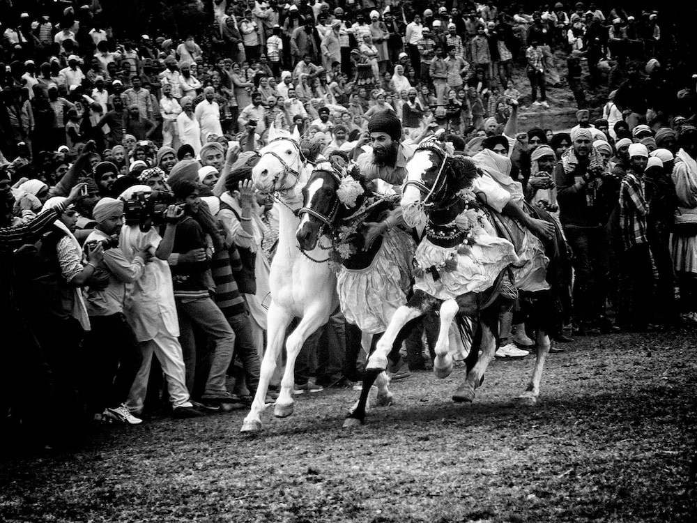 Black and white image of a horse race by Jagdev Singh