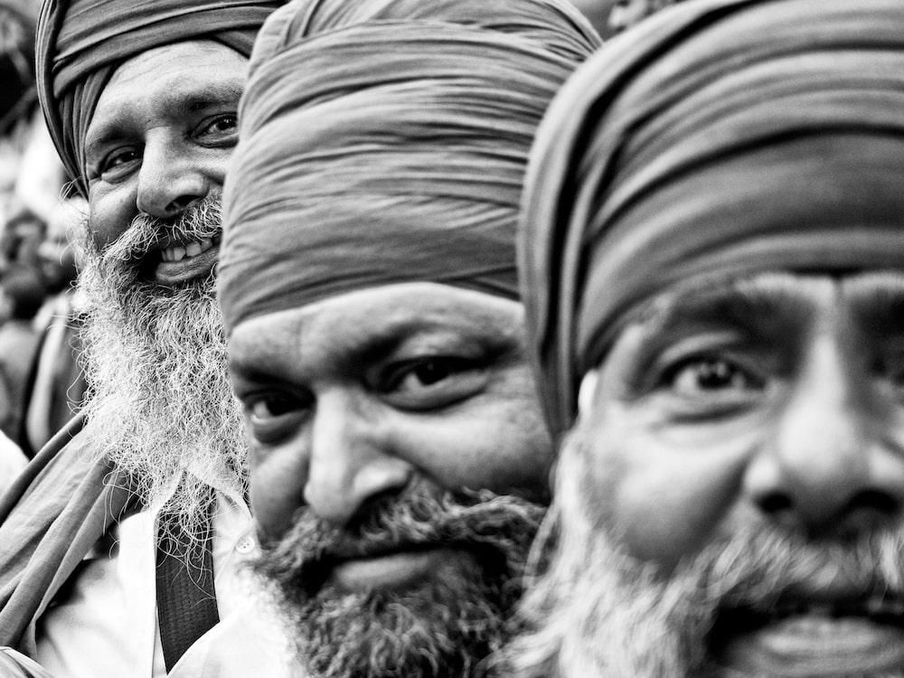 Black and white photo of four Men