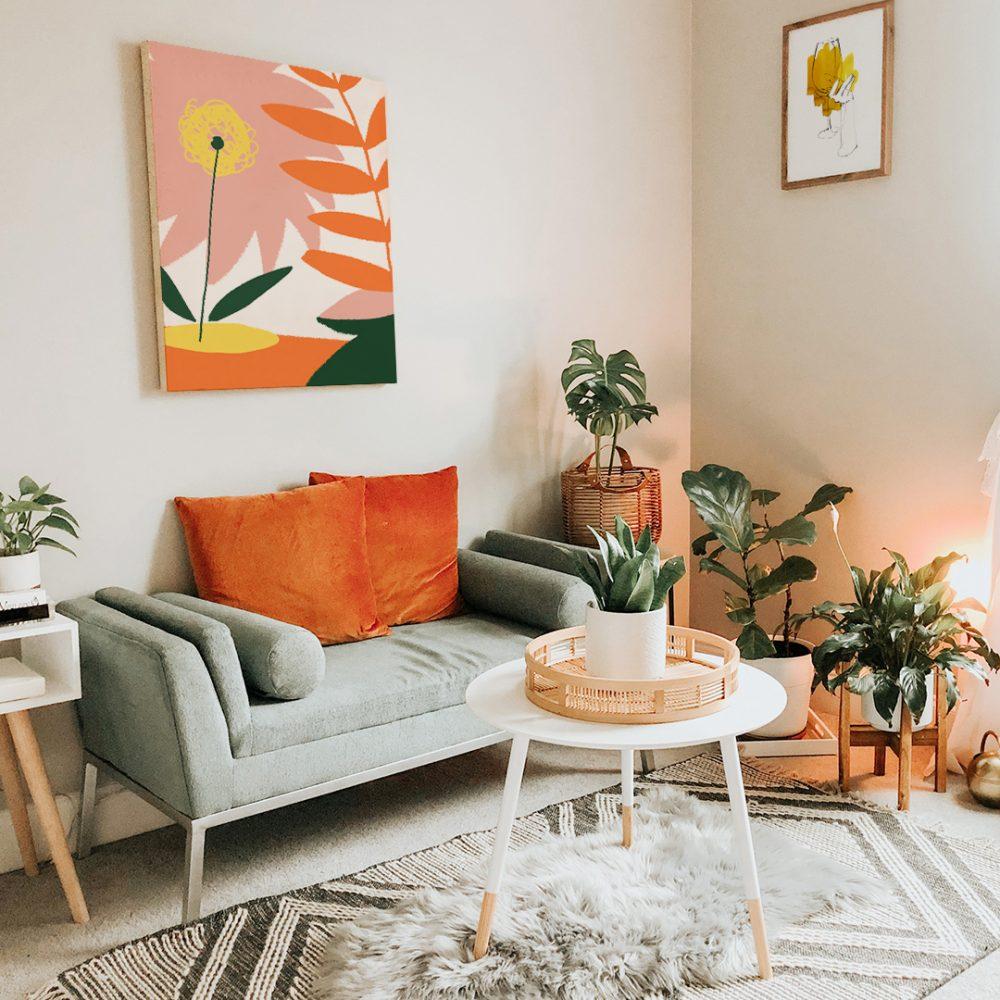 Boho Wohnzimmer: Highlights in orange und viele Pflanzen